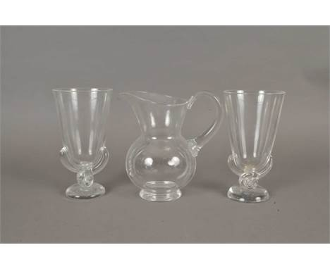 A pair of Steuben glass vases and a low-belled glass water jug mid-late 20th century the jug of low bellied form with wavy up