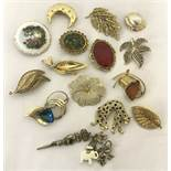 A small quantity of vintage brooches to include stone set and animal themed.