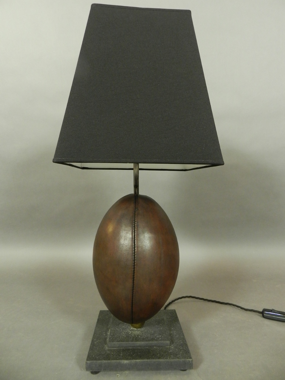 A table lamp, the base fashioned as a removable rugby ball