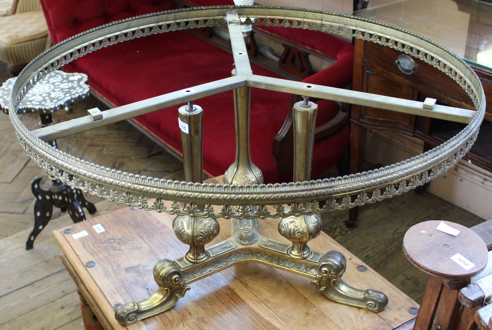 Lot 1055 - An ornate brass occasional table with galleried top (as found)