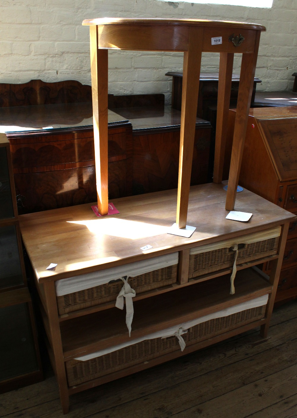 Lot 1018 - A reproduction 'D' end table and a wood and wicker drawer combination storage unit