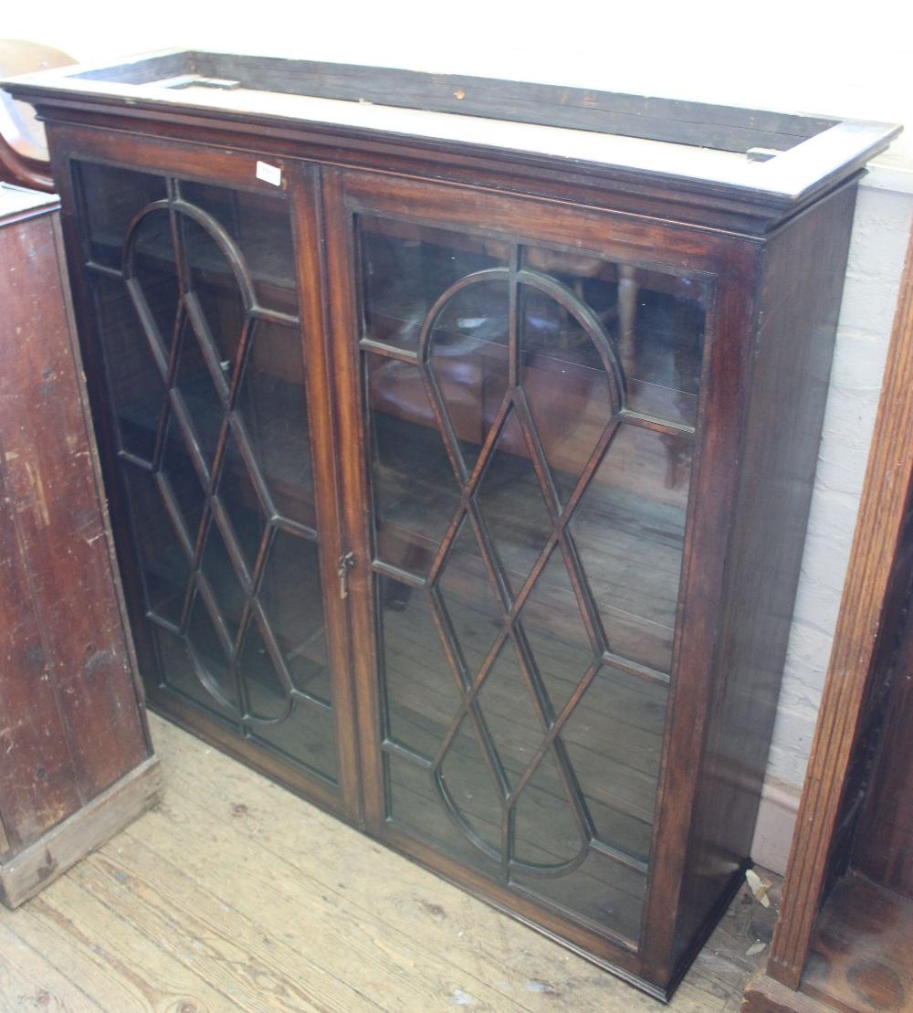 Lot 1011 - A mahogany two door bookcase
