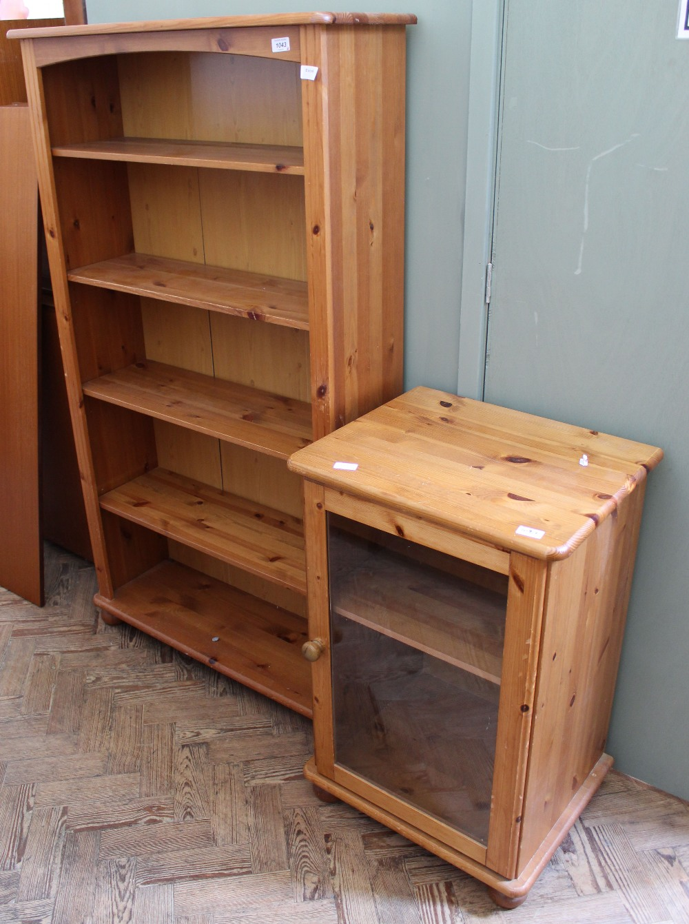 Lot 1043 - A large modern pine bookcase and a cabinet with glazed door