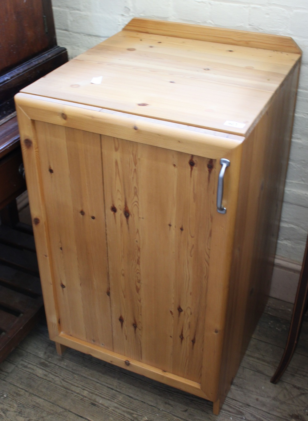 Lot 1003 - A modern pine one door cupboard and two open bookcases