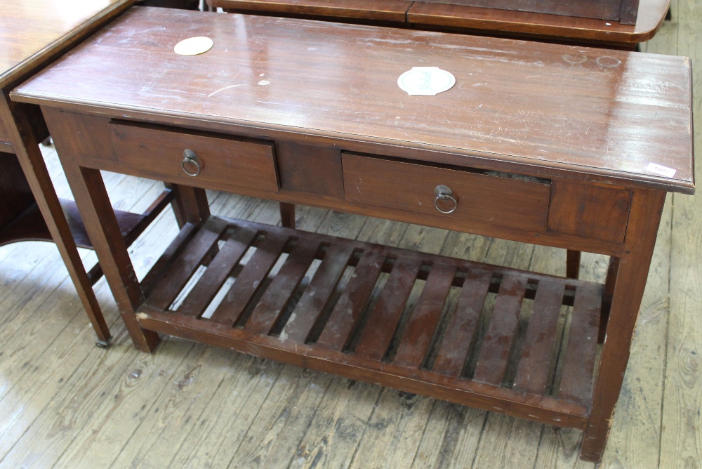 Lot 1002 - A reproduction two drawer pine serving table with under tier