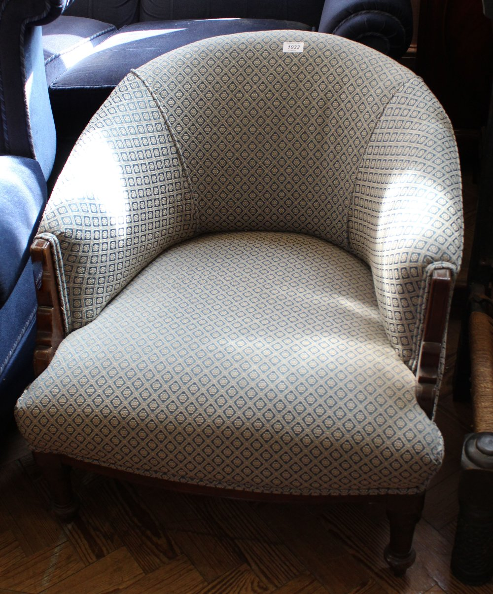 Lot 1033 - A late Victorian blue upholstered tub chair