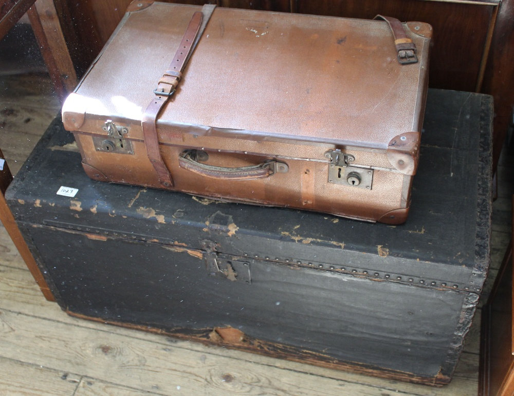 Lot 1023 - A large black travelling trunk and a vintage suitcase