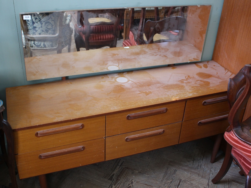 Lot 1039 - A retro 1970's G Plan dressing table with six drawers and mirror top