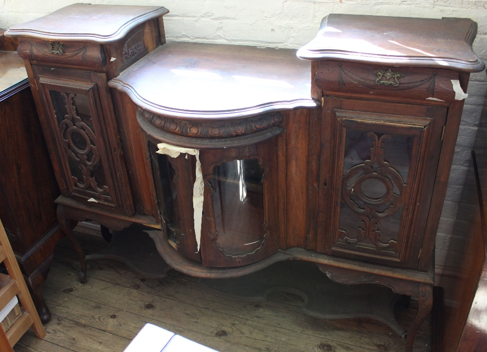 Lot 1019 - A carved and glazed bow fronted sideboard two drawers and three cupboards (as found)