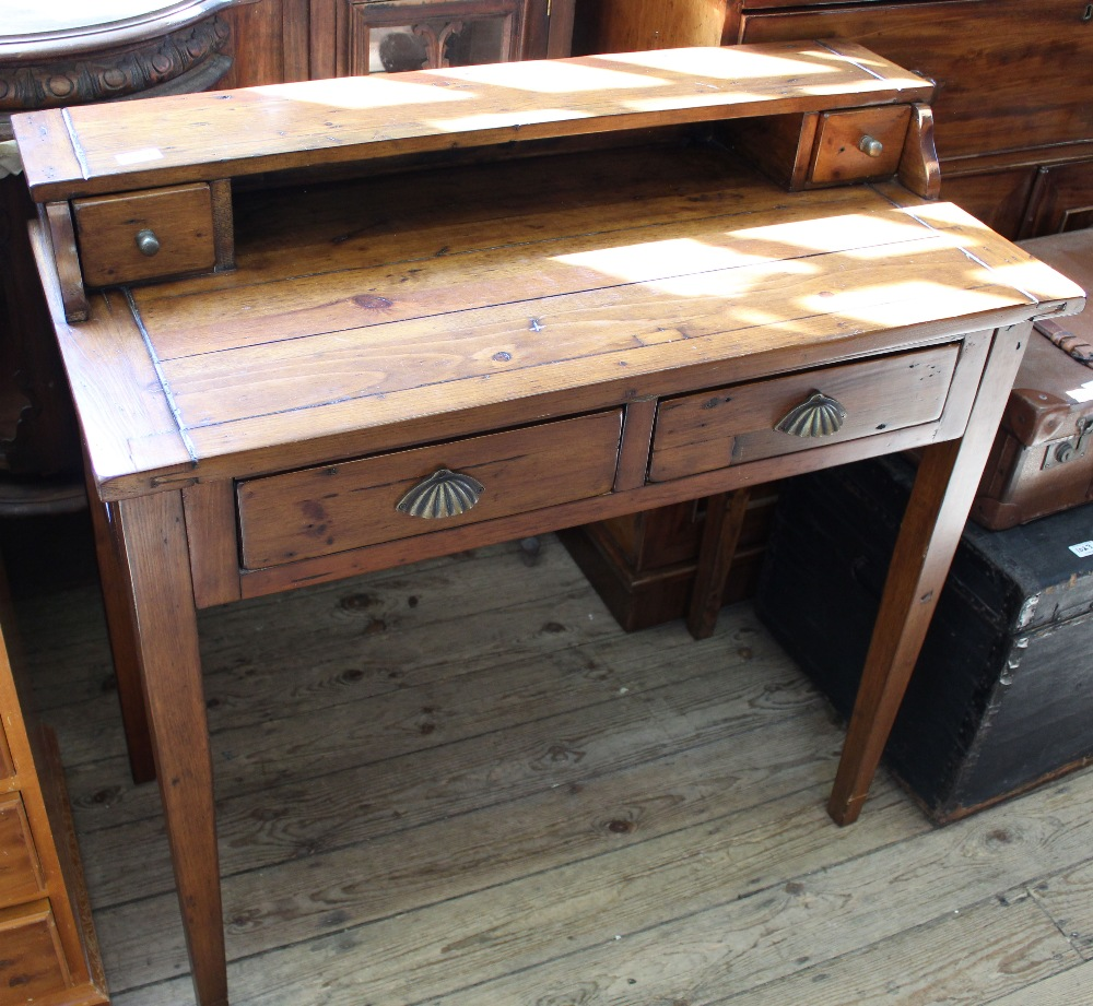 Lot 1021 - A modern two drawer desk on tapered legs with two drawer upstand