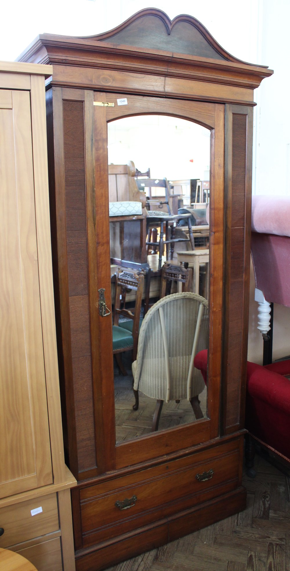 Lot 1049 - An Edwardian single wardrobe with drawer below