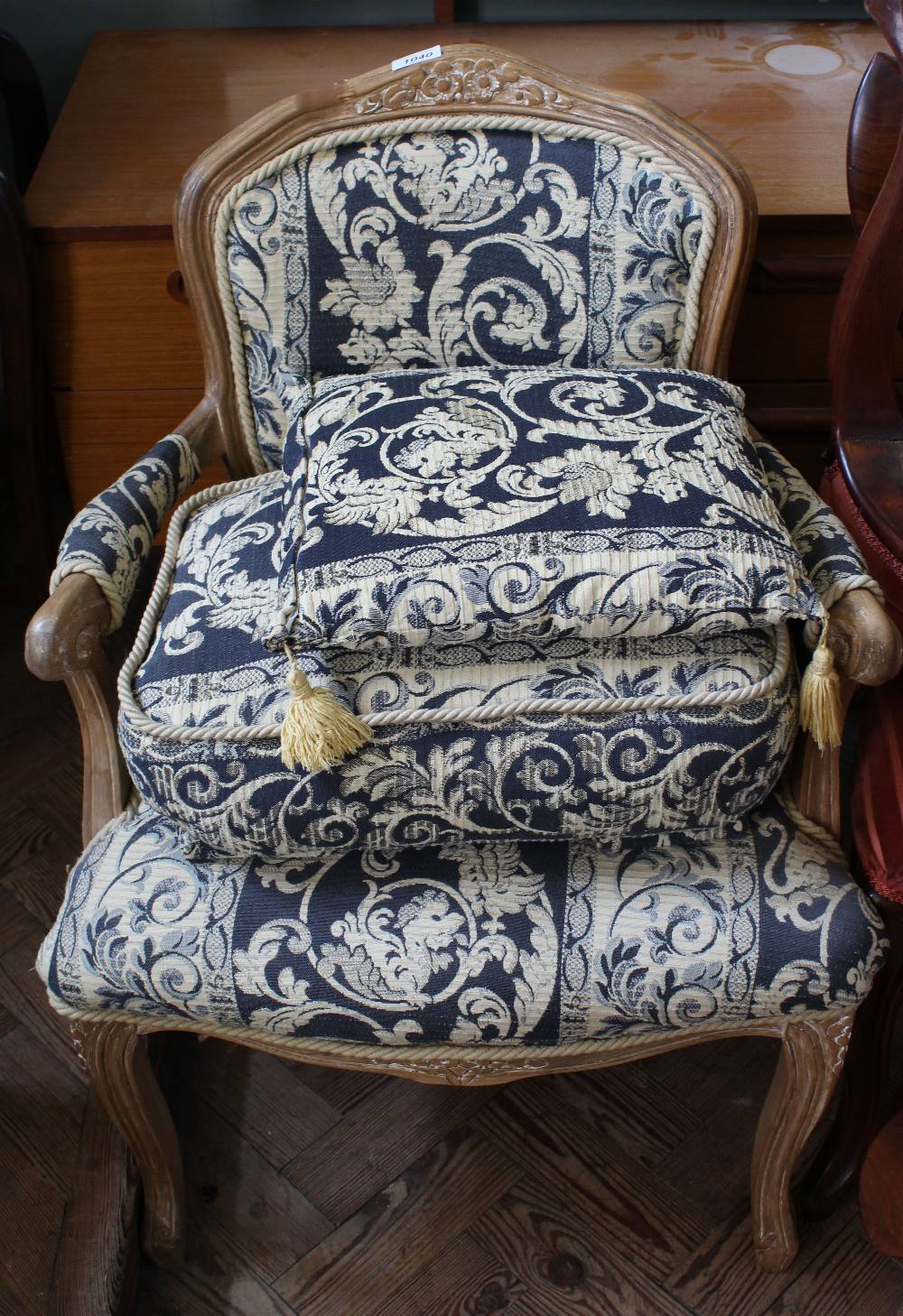 A French oak upholstered armchair,
