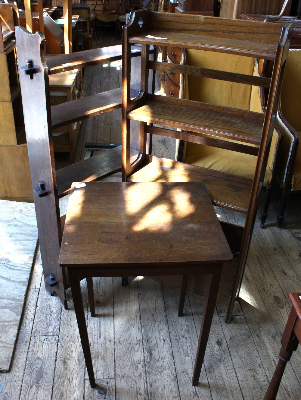 Lot 1013 - An oak Arts and Crafts style bookcase with internal magazine rack to base,