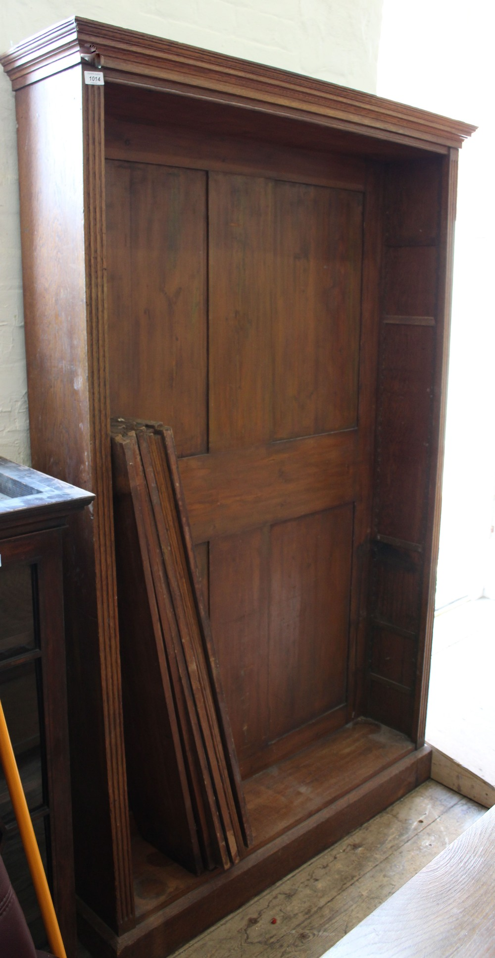 Lot 1014 - A substantial oak and pine bookcase