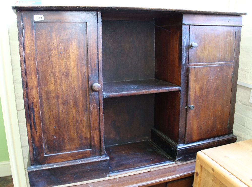 Lot 1001 - A country made pine combination cupboard