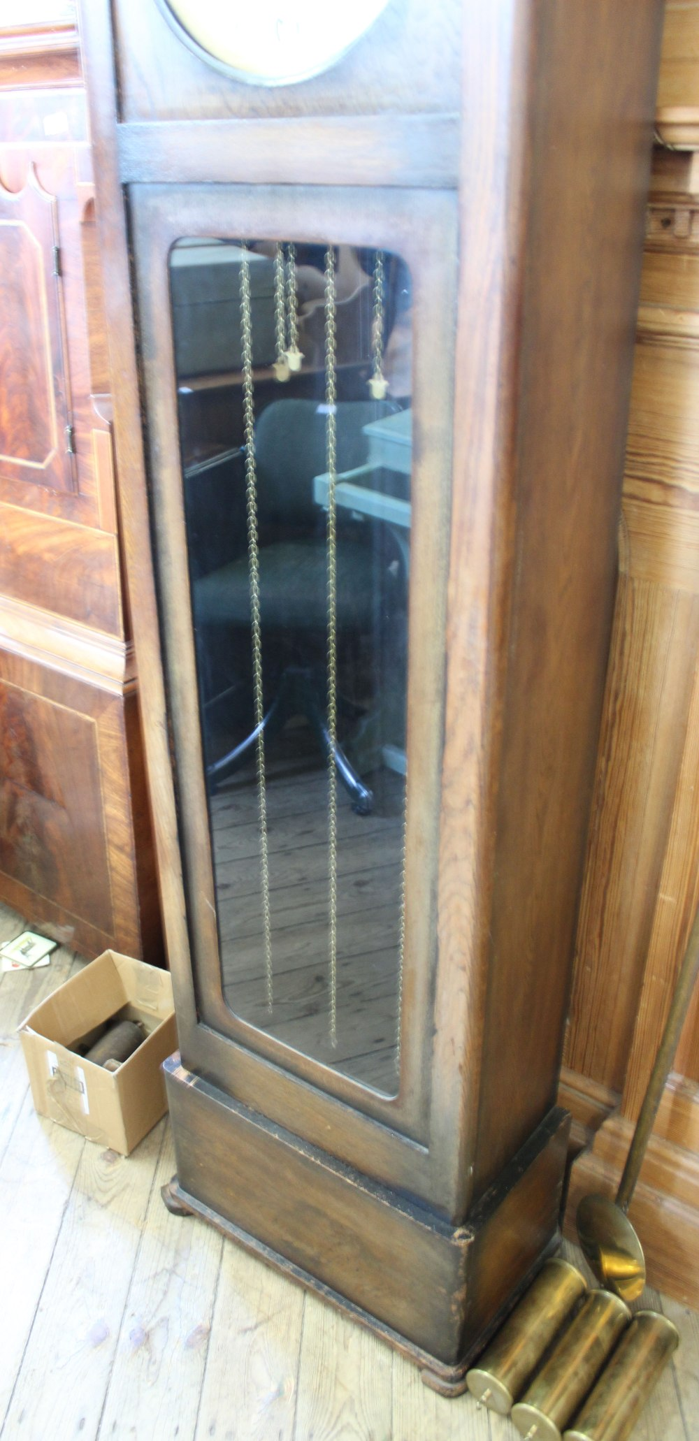 Lot 1060 - A 1920/30's oak long case clock