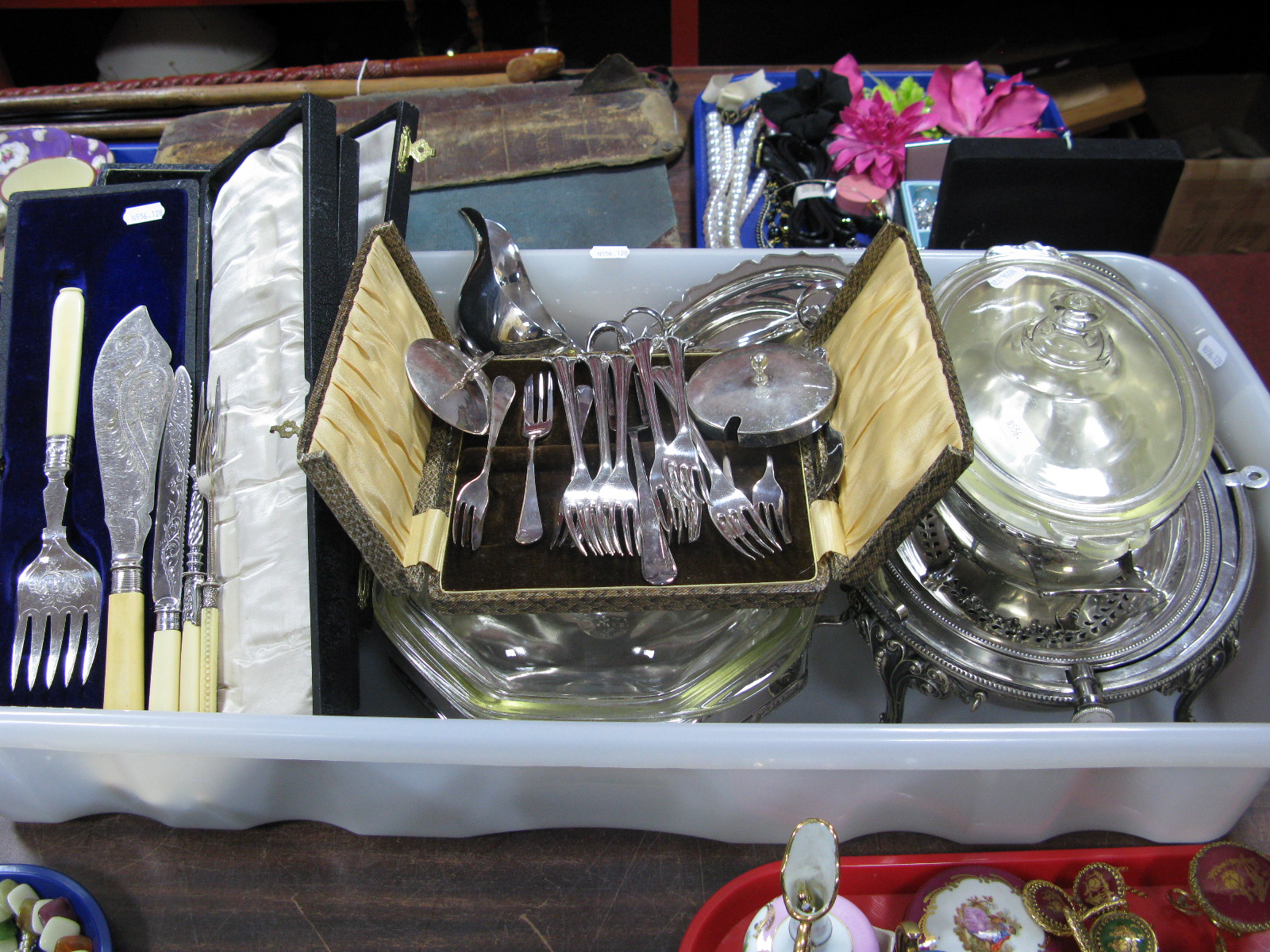 Lot 1095 - Glass Lined Tureens, a roll top breakfast server, sauce boats, decorative forks, cased fish servers,