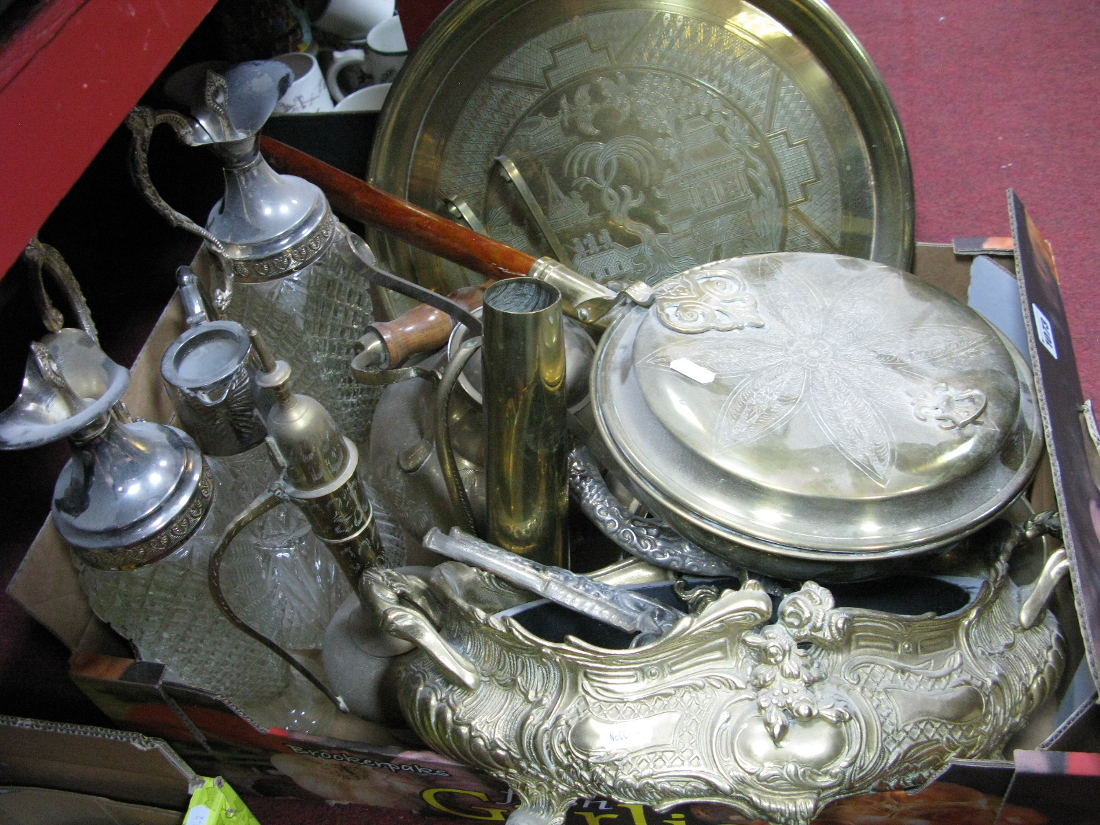 Lot 1073 - Brassware - warming pan, horse brasses, shell case, chargers, rococo scrolled planter, etc; ewers,