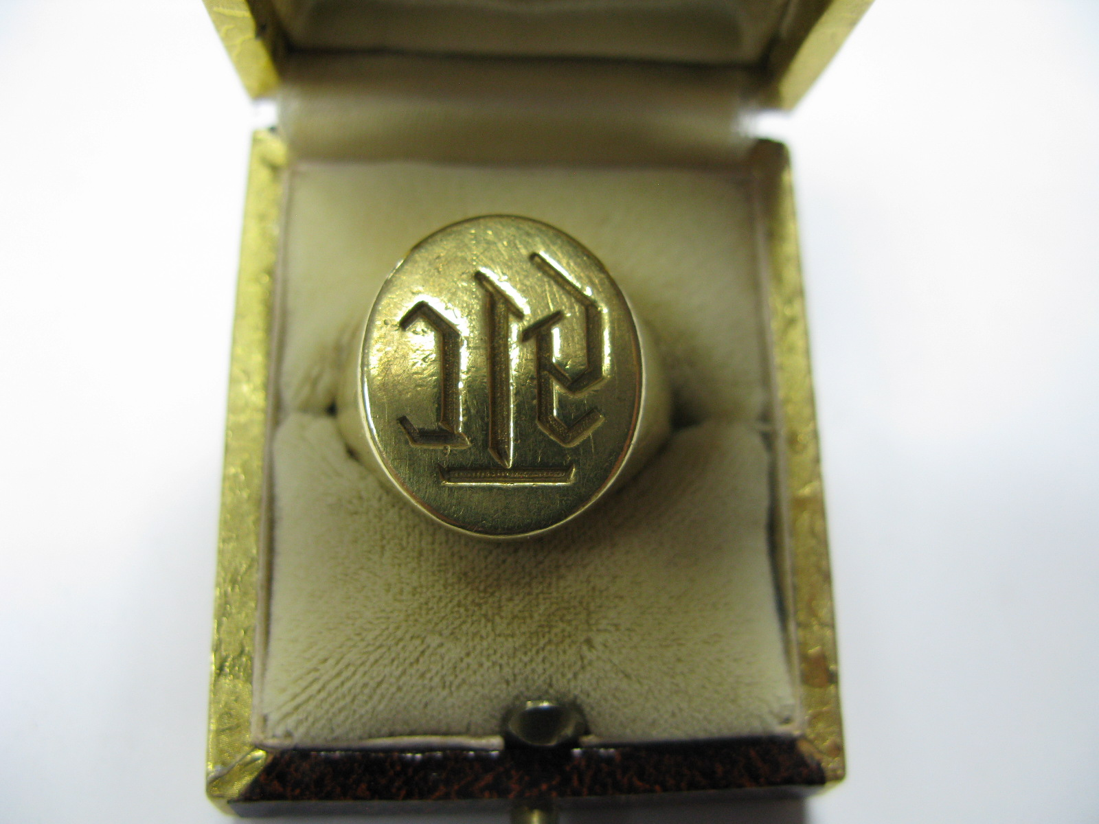 "Lot 1369 - A Gent's Signet Ring, initialled, indistinctly stamped ""750"" (shank cut)."