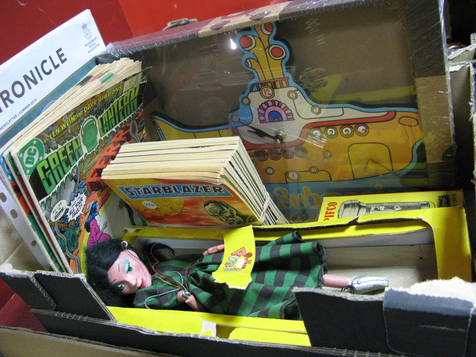 Lot 1008 - Pelham Puppet of Lady in Green & Black Check Dress, comics, yellow submarine clock,Henry Sandon