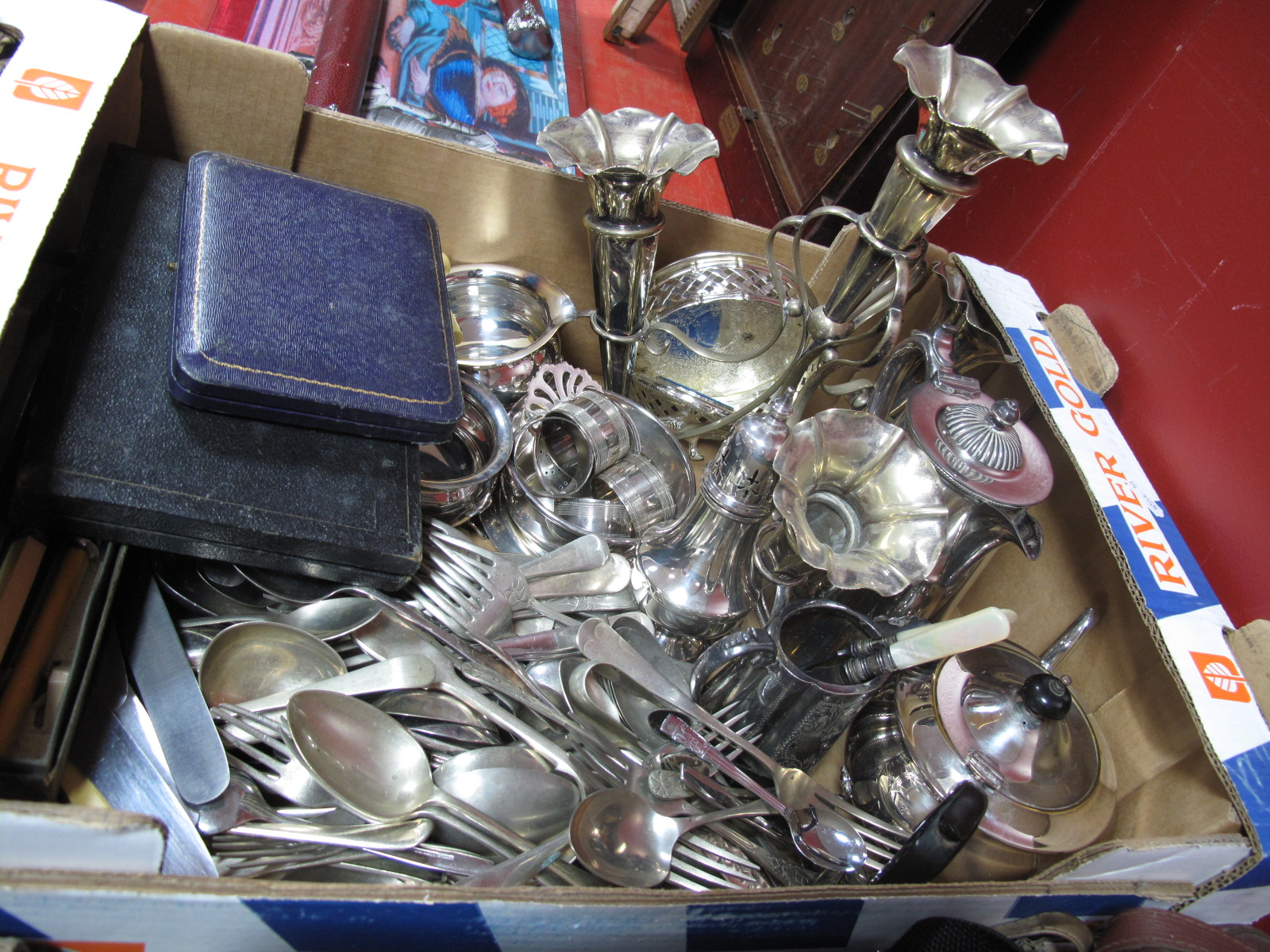 Lot 1003 - Epergne, plated tea ware, cutlery cased and loose, etc:- One Box