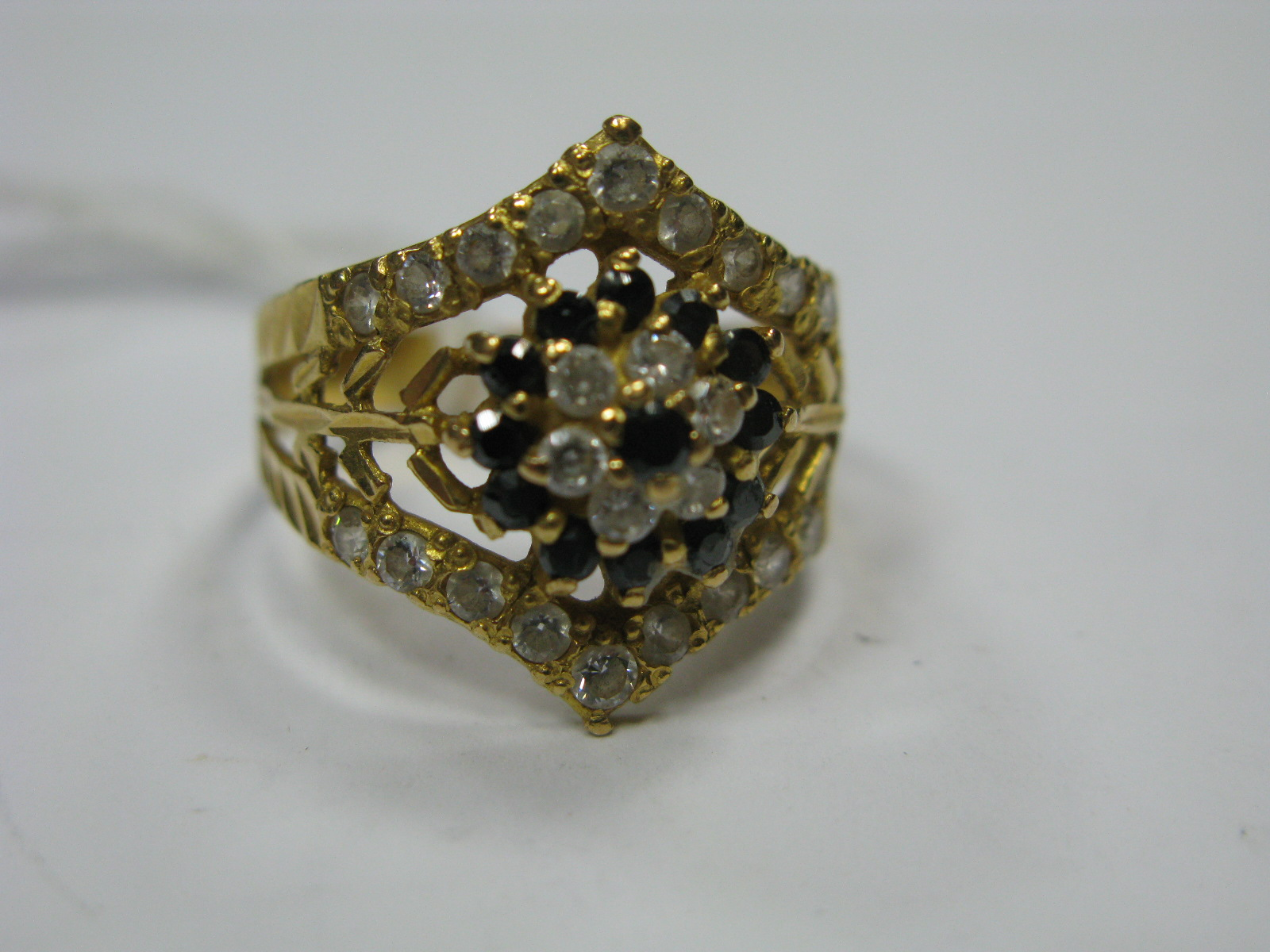 """Lot 1357 - A Stone Set Ring, with cluster style centre and wishbone frame, stamped """"22K""""."""