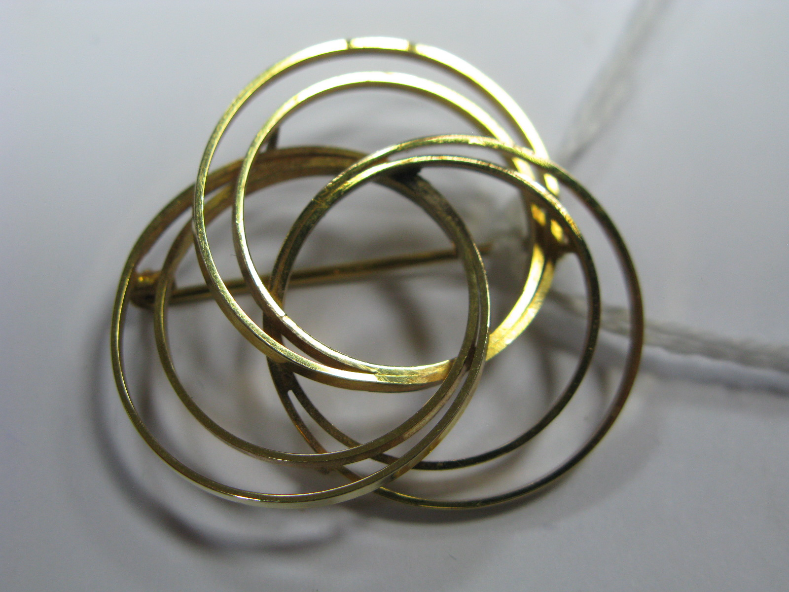 Lot 1364 - A 9ct Gold Modern Circular Design Brooch.