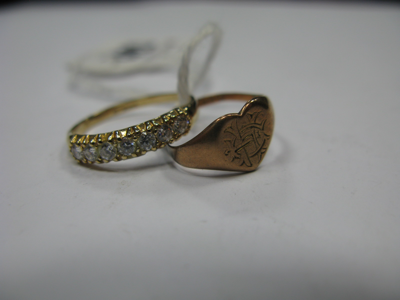 Lot 1342 - A 9ct Gold Stone Set Ring, claw set, with a 9ct gold engraved heart shape signet ring (