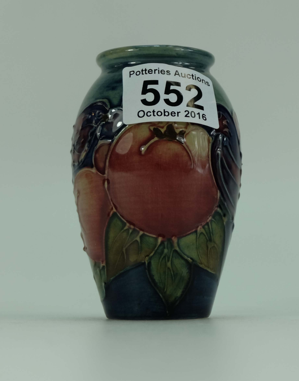 Moorcroft vase decorated in Chaffinch and Berry design on blue ...