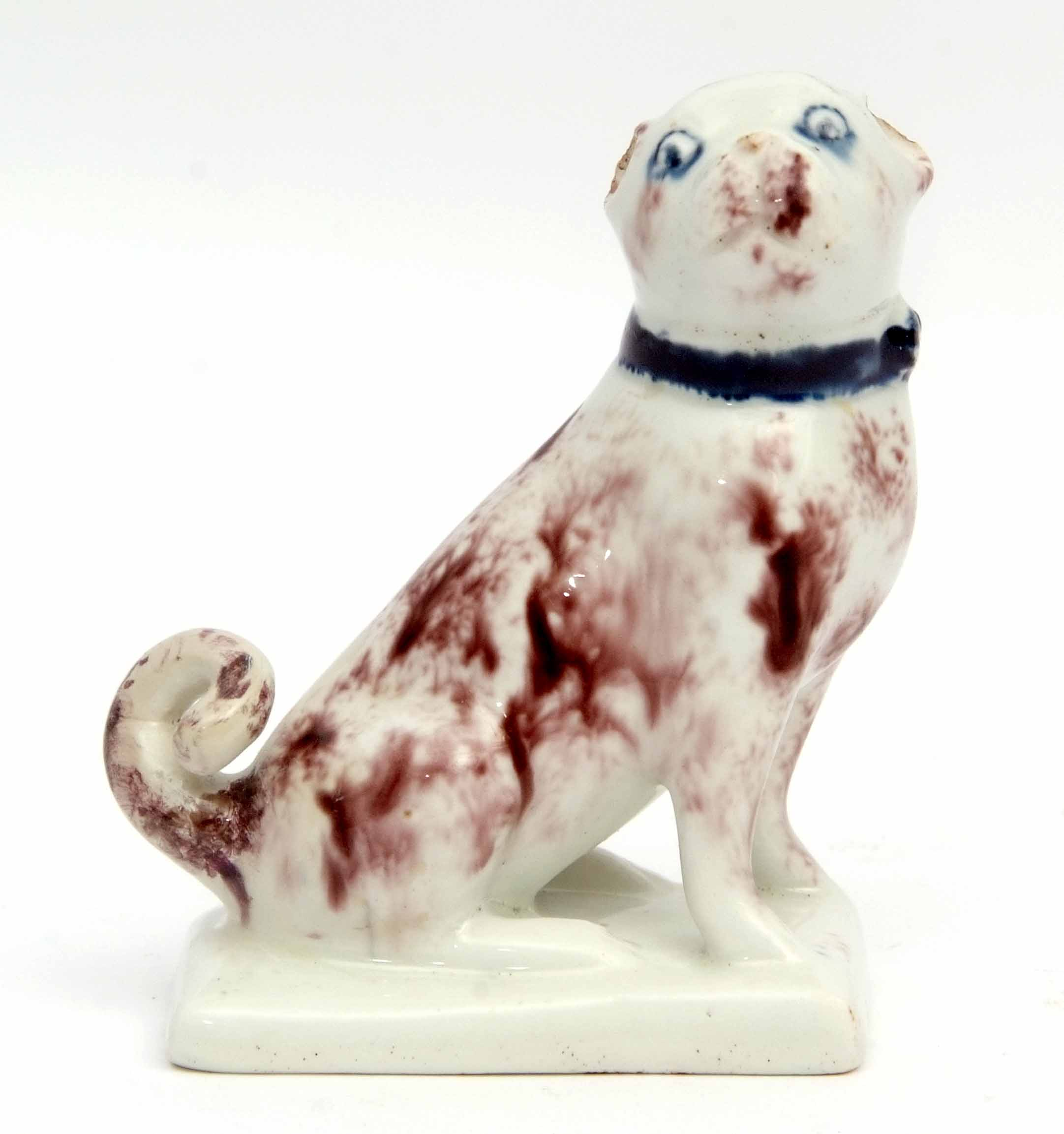Very rare Lowestoft model of a pug dog, the animal sits on its haunches on a rectangular base, the