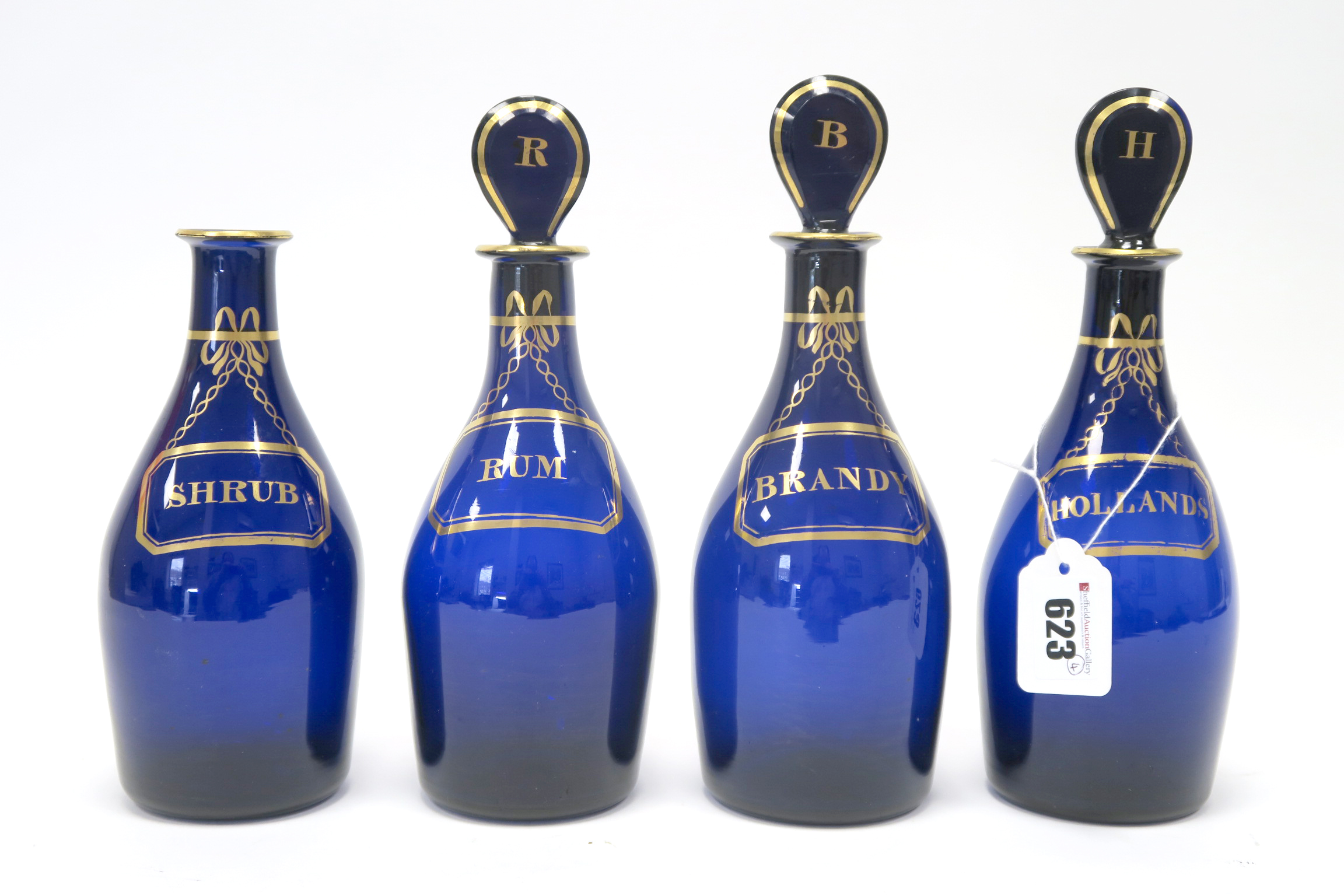 Lot 623 - A Set of Four Early XIX Century 'Bristol' Blue Decanters, of mallet form, with three bulls eye