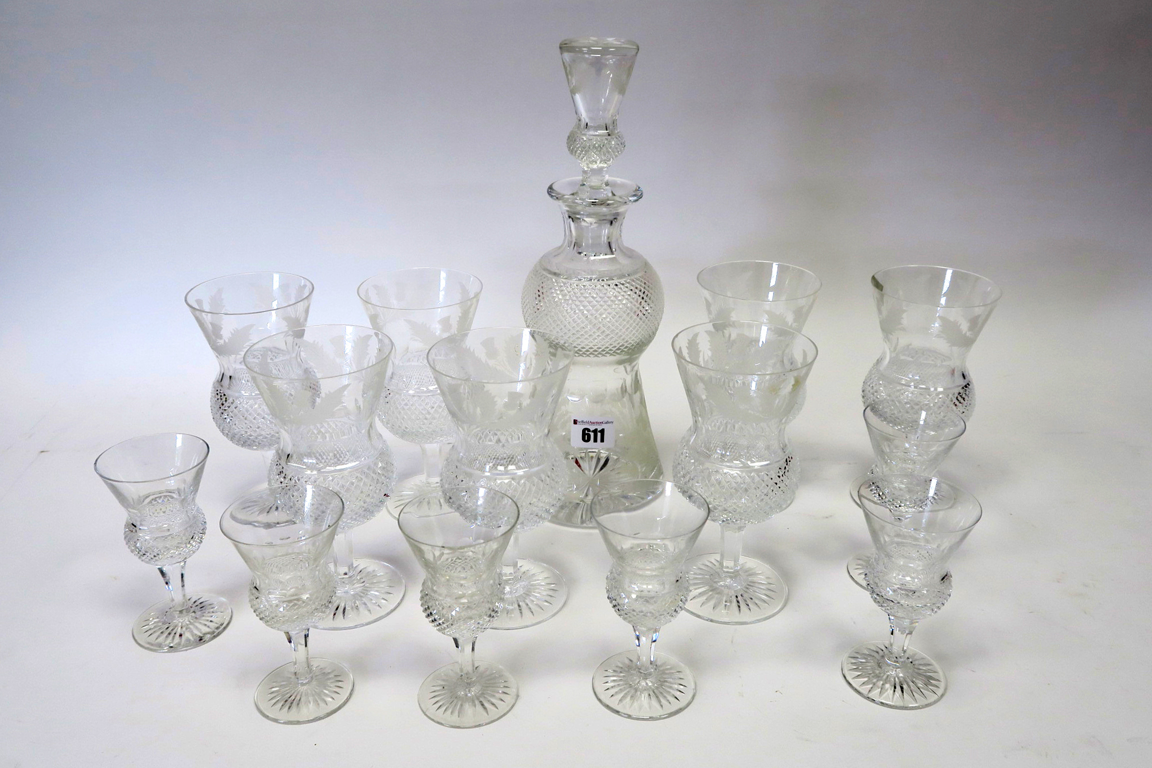 Lot 611 - An Edinburgh Crystal Part Suite of 'Thistle' Pattern Glassware, each piece etched with thistles