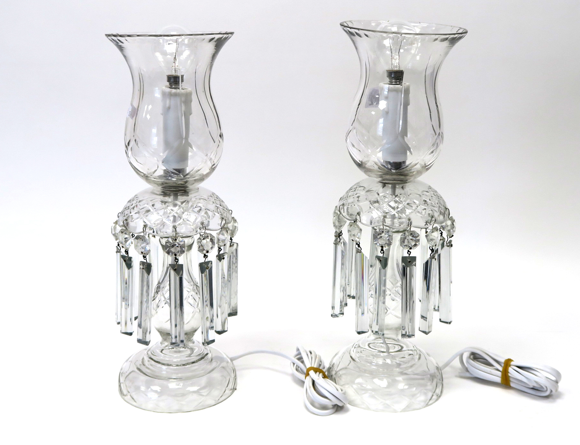 Lot 602 - A Pair of Glass Table Lamps, with bell shape shades and faceted lustre drops to baluster columns and