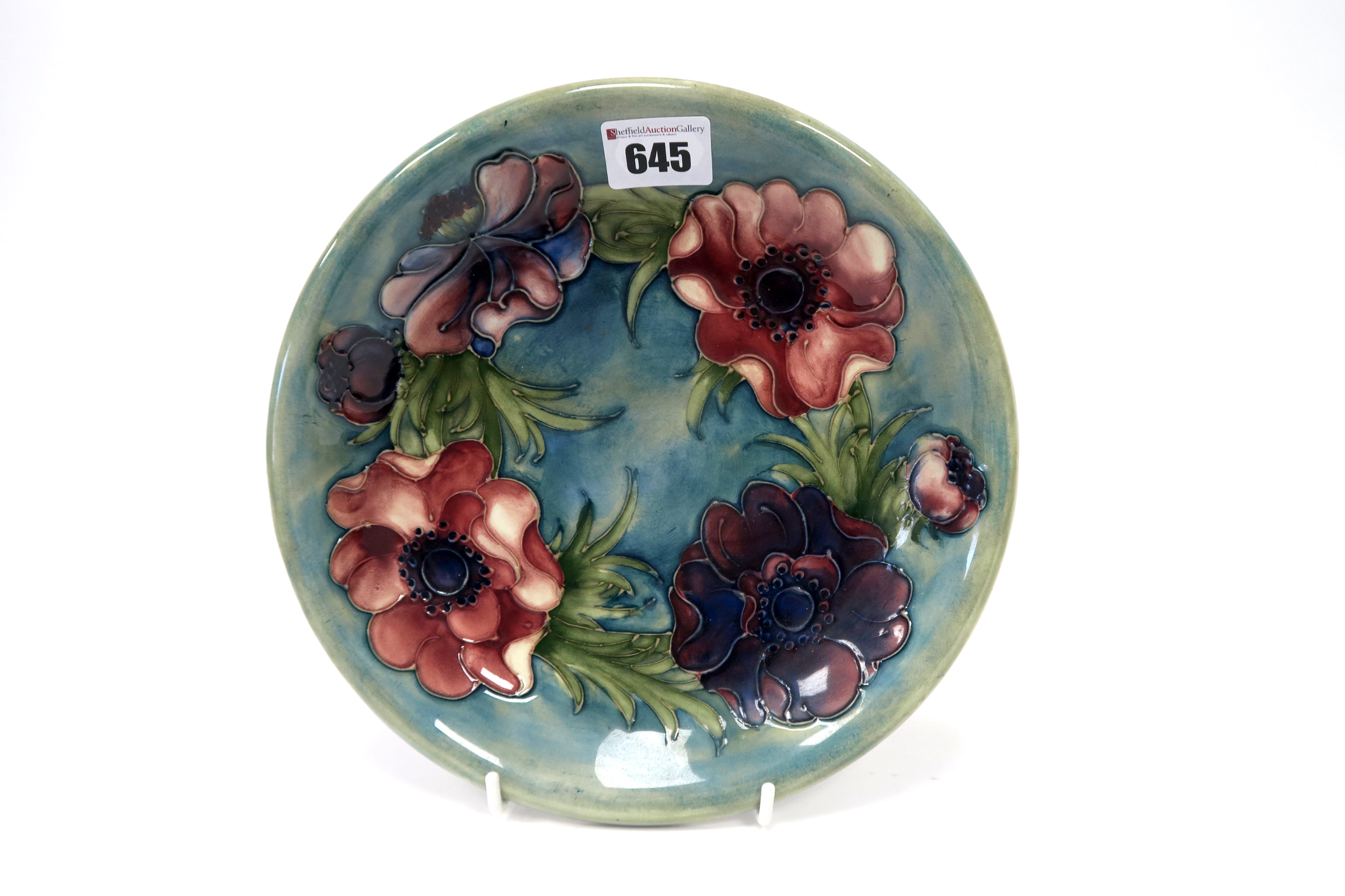 Lot 645 - A Mid XX Century Moorcroft Pottery Dish, of circular form, painted in the 'Anemone' pattern with