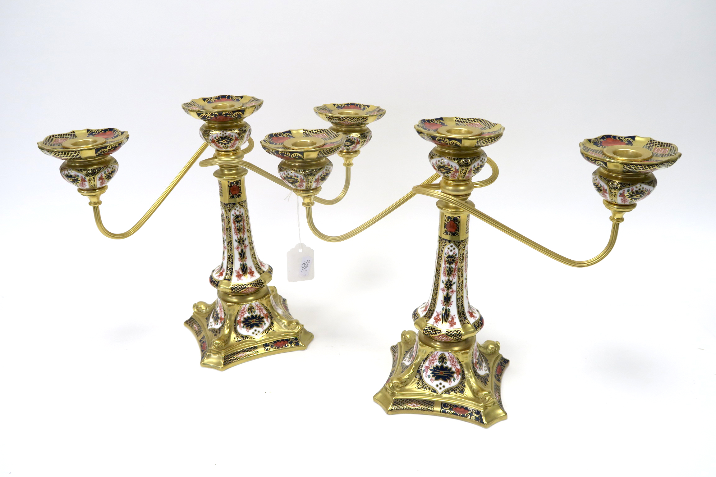Lot 648 - A Pair of Royal Crown Derby Porcelain Two Branch Candelabra, with gilt metal mounts, the tapered