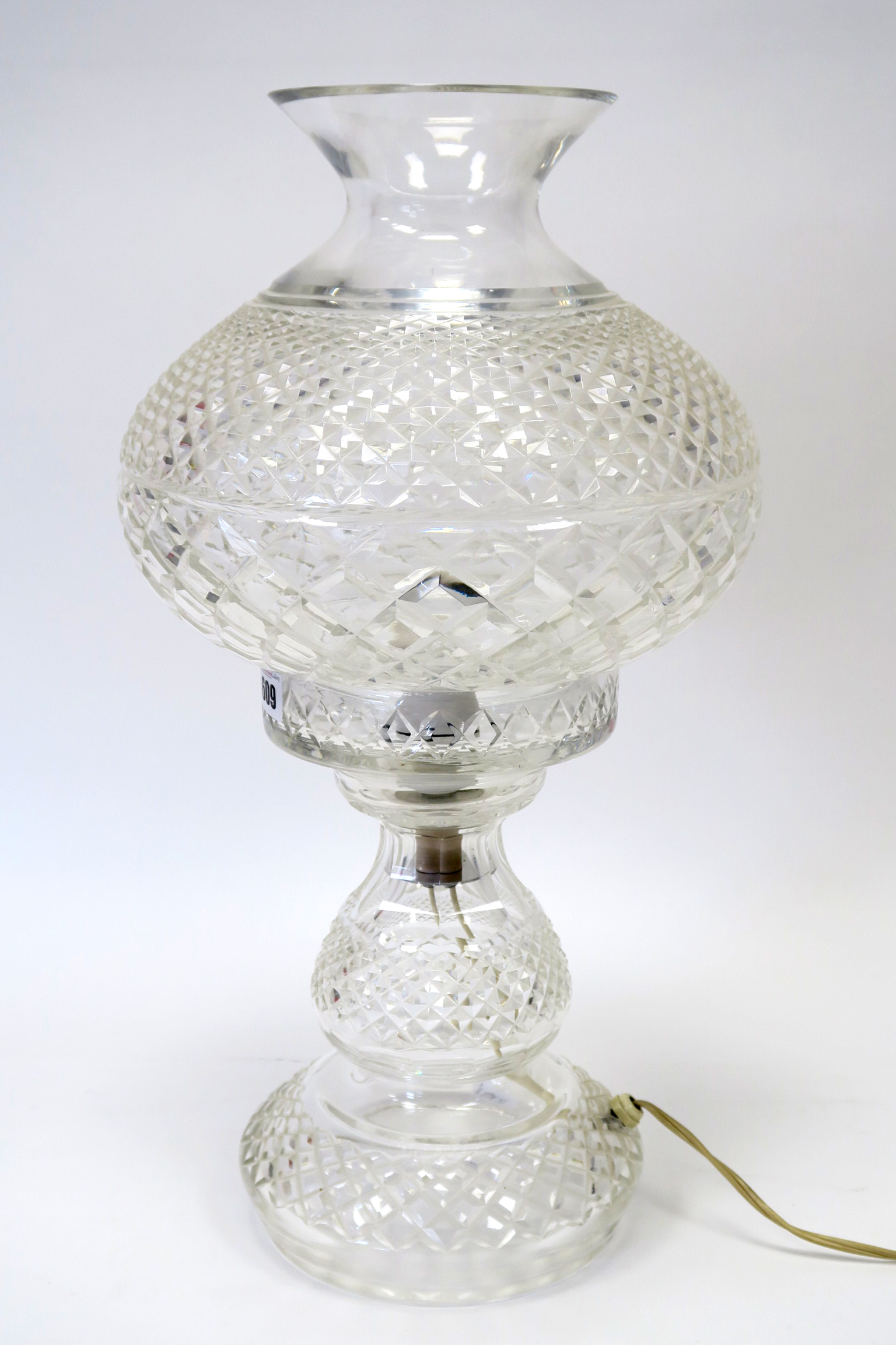 Lot 609 - A Waterford Crystal Table Lamp, with hobnail decoration, the bulbous shaped shade with flared neck