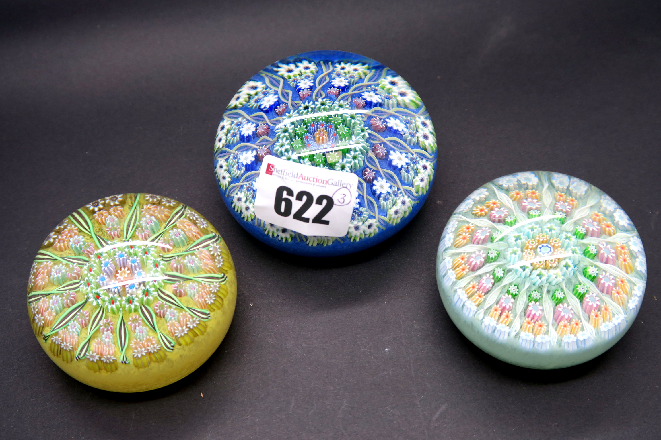 Lot 622 - A Late XX Century Perthshire Cartwheel Paperweight, with sections of millefiore canes between