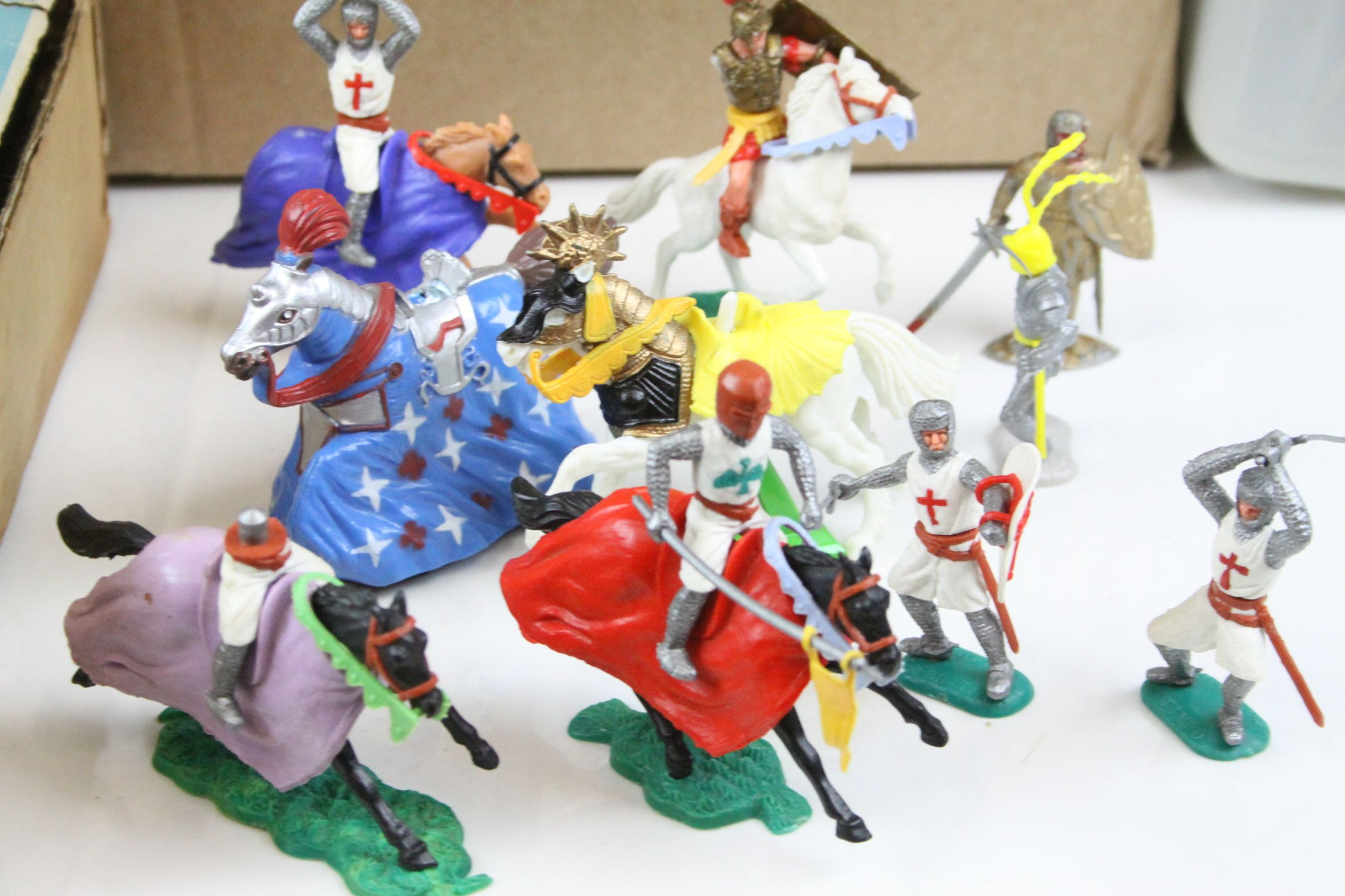 Lot 451 - A collection of plastic Knights & Knights on horseback by Britains and Timpo together with a Knights