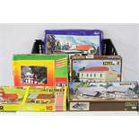 Five boxed HO/OO gauge model railway trackside model kits to include 3 x Faller (1101, 370 &