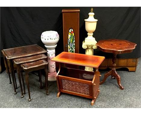 An Italian style inlaid tripod table, shaped circular top; nest of three mahogany tables, glass inlay; a jardinière & sta