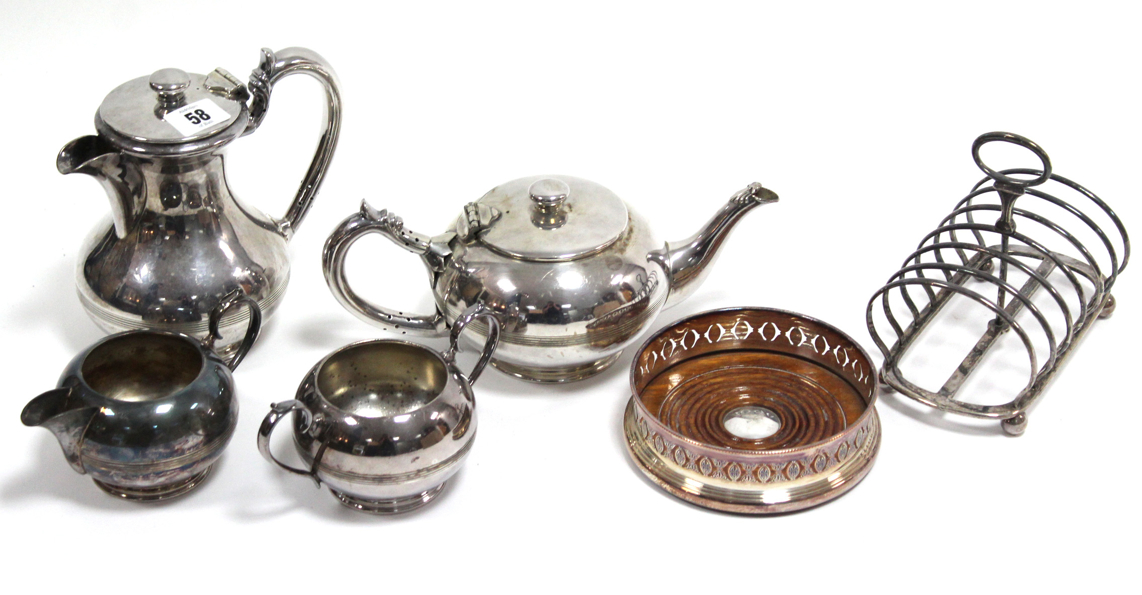 Lot 58 - A Walker & Hall silver plated four piece tea & coffee service; a silver plated coaster; & a plated