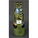 Lot 46 - A Loetz style iridescent multicoloured drawn and banded bottle shaped vase with applied relief