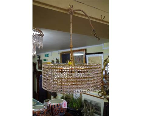 A vintage Lobmeyr brass eight bulb five tier chandelier; together with another four tier chandelier.