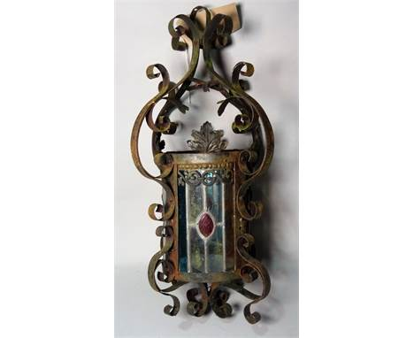A modern wrought iron and stained glass hanging lantern, 50cm high.