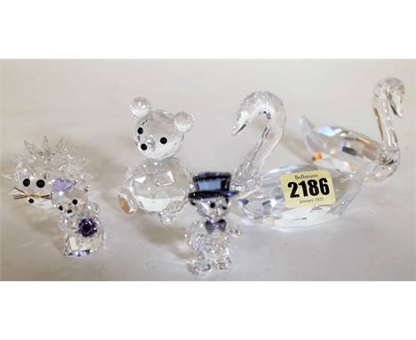 Swarovski, a group of six animal figures, the largest 10cm high, (6).  Condition Report Two swans with chipped tails, Hedgeho