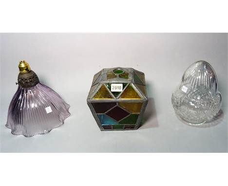 An early 20th century stained glass shade of tapering form, 16cm wide x 19cm high, and two later glass shades, (3).