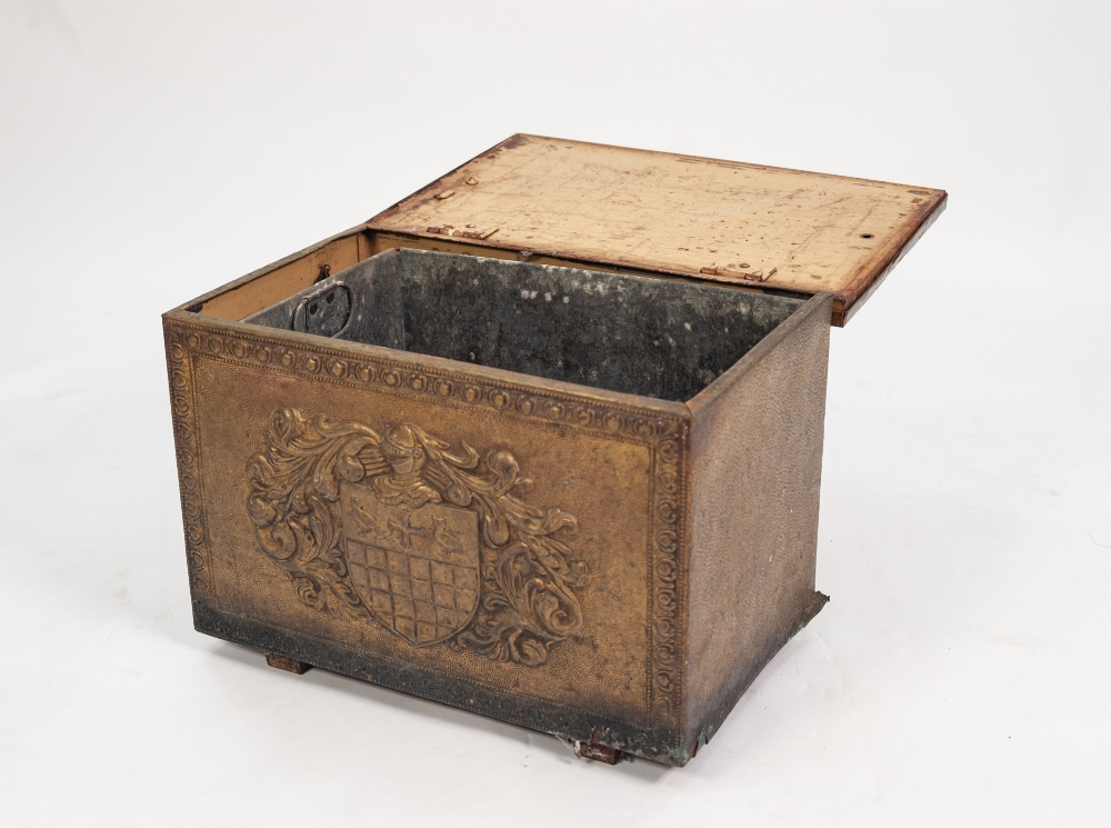 Lot 82 - AN EARLY 20TH CENTURY BRASS EMBOSSED COAL BOX, depicting heraldic emblem to the top, with metal