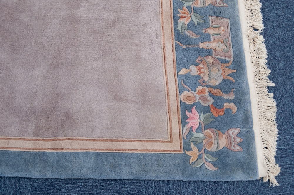 Lot 29 - WASHED CHINESE SMALL CARPET with plain mushroom field, the pale green border having plain narrow