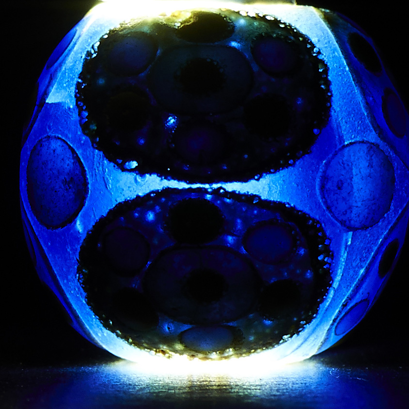 Lot 312 - A CHINESE 'CONCENTRIC-CIRCLE' CIRCULAR MOSAIC GLASS BEAD