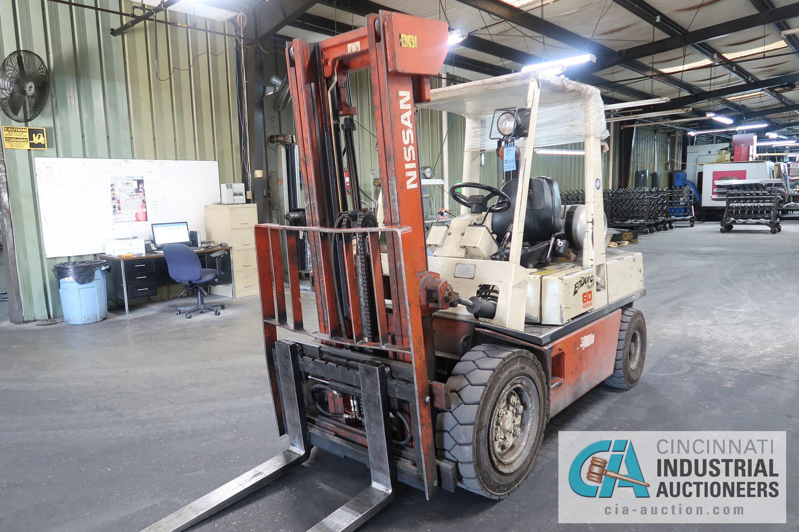 6,000 LB. CAPACITY NISSAN MODEL KUGH02A30V LP GAS, TWO STAGE MAST, SOLID PNEUMATIC TIRE LIFT
